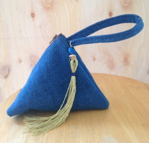 Blue denim triangle wristlet bag